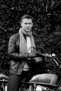 Reducing motorcycle noise with scarf and helmet